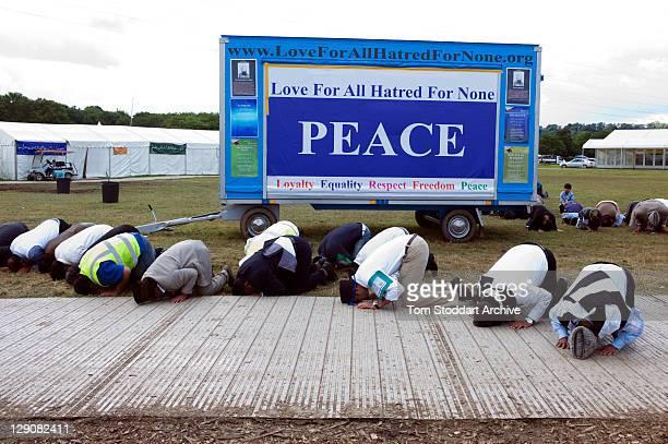 Muslims pray under a peace banner at the 45th Jalsa Salana Ahmadiyya Annual Convention held at Oakland Farm near Alton Hampshire 24th July 2011 The...