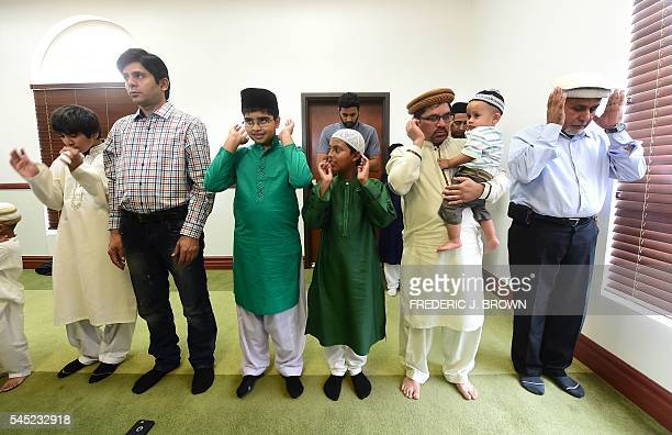 Muslims pray while celebrating Eid alFitr marking the end of fasting during the monthlong Ramadan at the Baitul Hameed Mosque in Chino California on...