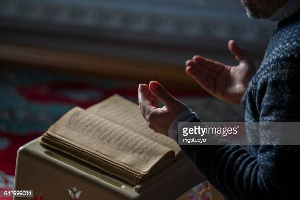 muslims prayer in mosque - koran stock pictures, royalty-free photos & images