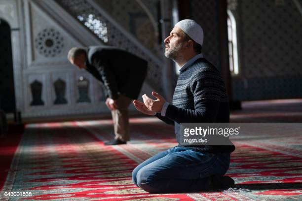 muslims prayer in mosque - muslim praying stock pictures, royalty-free photos & images