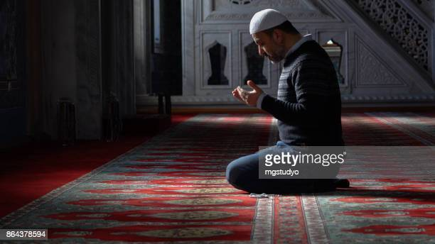 muslims prayer in mosque - mosque stock pictures, royalty-free photos & images