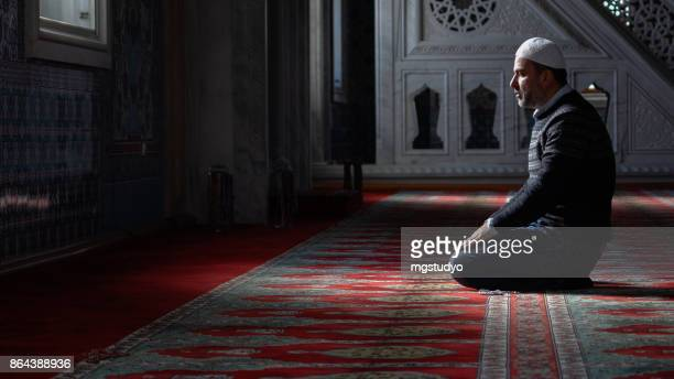 muslims prayer in mosque - mosque stock photos and pictures
