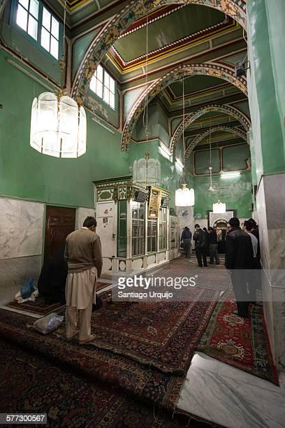 Muslims praying at Umayyad Mosque