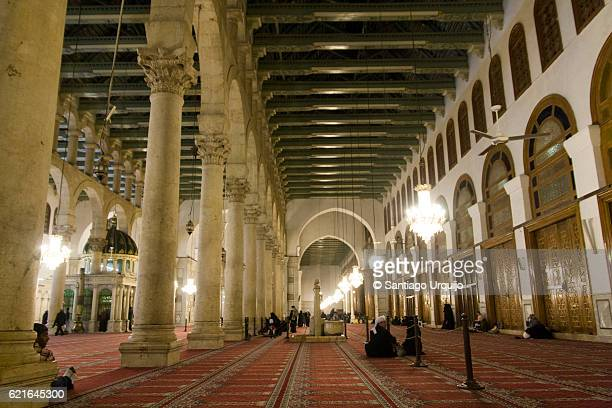 Muslims praying at Umayyad Mosque