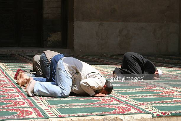 Muslims Praying in a mosque in Cairo, Egypt.