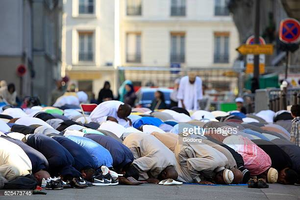 Muslims praying outside the Paris Great Mosque on Aid ElFitr festival
