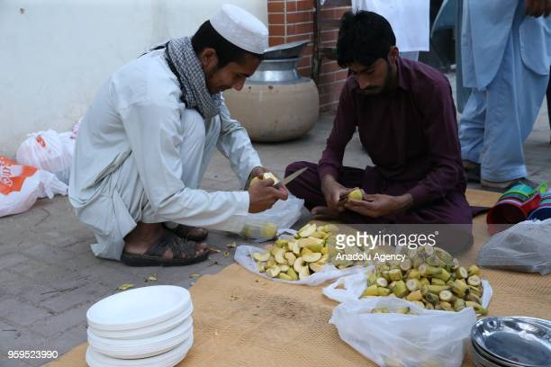 Muslims prepare for the first iftar dinner of the holy Islamic month of Ramadan in Islamabad Pakistan on May 17 2018 Traditional meals including...
