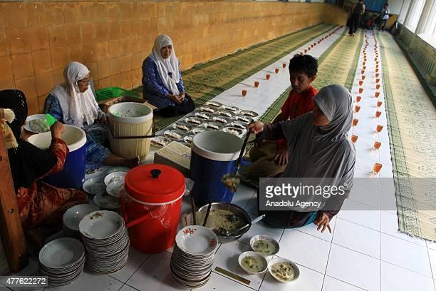 Muslims prepare meals to break their fast at a fastbreaking dinner during Ramadan in Surakarta Central Java Indonesia on June 18 2015