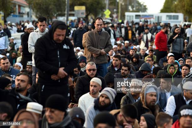Muslims prepare to offer Eid alAdha prayers on the road outside the Lakemba mosque in Sydney on September 1 2017 Muslims living in Australia are...