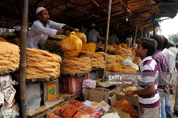 Muslims purchase sweet vermicelli at market ahead of the Muslim festival Eid alFitr in Noida India on Thursday August 08 2013 Eid alFitr an Islamic...