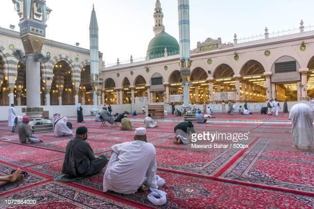 MEDINA-MAR 9 : Muslims read Quran and pray inside of Masjid Nabawi March 9, 2015 in Medina, Saudi Ar