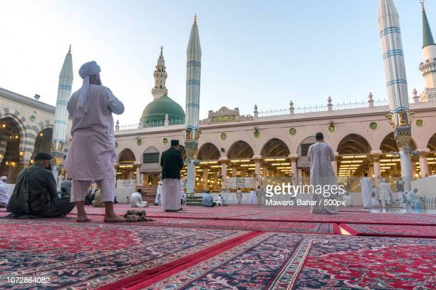 MEDINA-MAR 9 : Muslims read Quran and pray inside of Masjid Nabawi March 9, 2015 in Medina, Saudi Ar