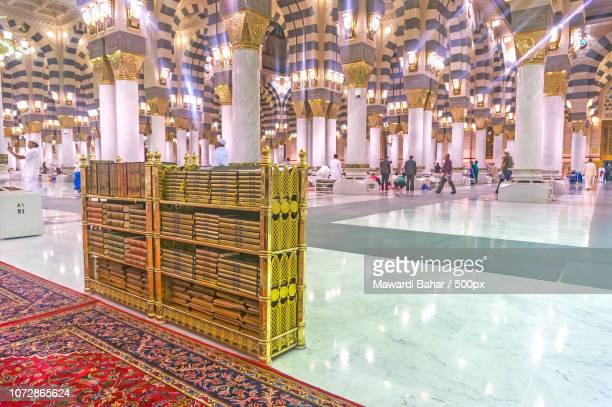 MEDINA-MAC 9 : Muslims read Quran and pray inside of Masjid Nabawi March 9, 2015 in Medina, Saudi Ar