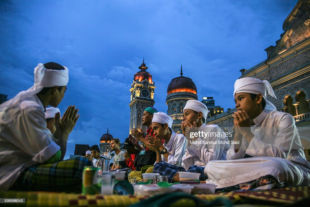 Muslims recite a prayer before they break their fast during the holy month of Ramadan at Dataran Merdeka (Independent Square) on June 11, 2016 in Kuala Lumpur, Malaysia. Muslims around the world are observing the fasting month of Ramadan, Islam's holiest month, during which observant believers fast from dawn to dusk. They celebrate the end of the Ramadan with the Eid al-Fitr festival.