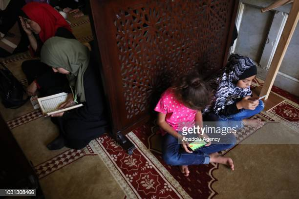 Muslims recite from the holy Qur'an during the 1 Muharram 1440 Hijriah celebrations marking Islamic new year after performing noon prayer at the...