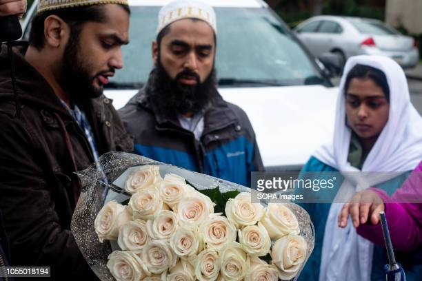 Muslims seen at the site of the shooting to mourn victims from the deadly mass shooting After the tragic shooting in Pittsburgh PA at the Tree of...