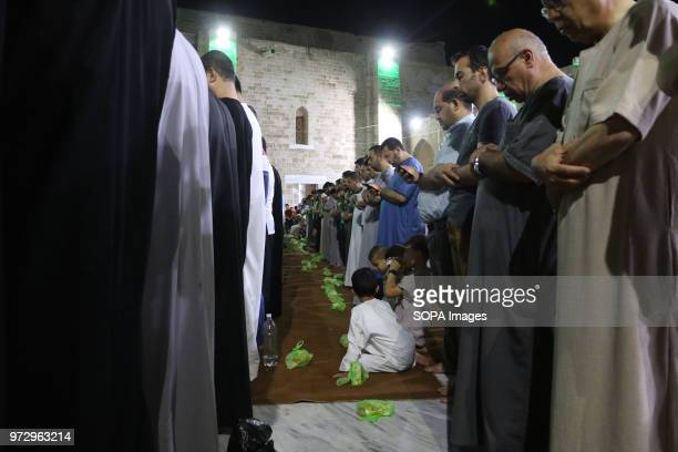 Muslims seen performing prayers during the ramadan Palestinian worshippers attend a night prayer during Laylat AlQadr on the 27th day of the holy...