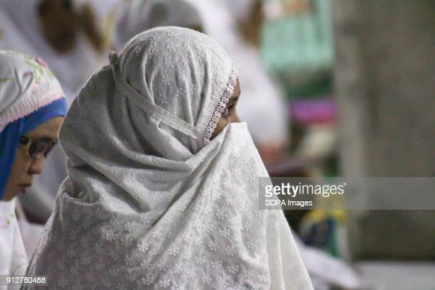 LHOKSEUMAWE ACEH INDONESIA Muslims seen praying during the moon eclipse phenomenon in Lhokseumawe The phenomenon of a rare lunar eclipse occurs...