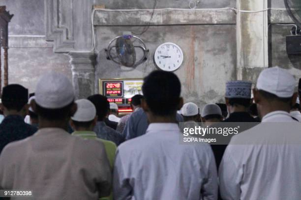 LHOKSEUMAWE ACEH INDONESIA Muslims seen praying together during the moon eclipse phenomenon in Lhokseumawe The phenomenon of a rare lunar eclipse...