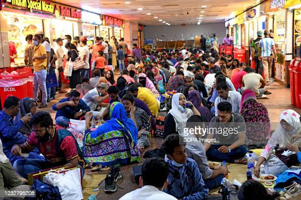 Muslims seen taking Iftar without maintaining social distance at Bashundhara City Shopping Complex ahead of Eid in Dhaka.