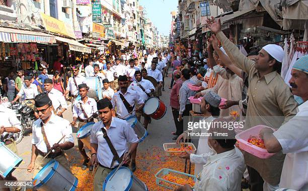 Muslims shower flower petals on cadres of RSS who are conducting Path Sanchalan on the occasion of Vijayadashmi outside the shrine of Sufi Saint...