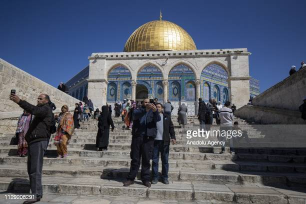 Muslims take a selfie as they arrive to perform Friday prayer at AlAqsa Mosque Compound in Jerusalem on March 08 2019