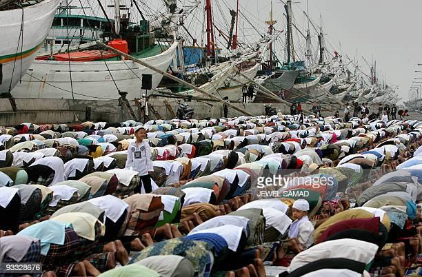 Muslims take part in a special morning prayer at the Sunda Kelapa port in Jakarta 13 October 2007 to start EidalFitr festival The world's most...