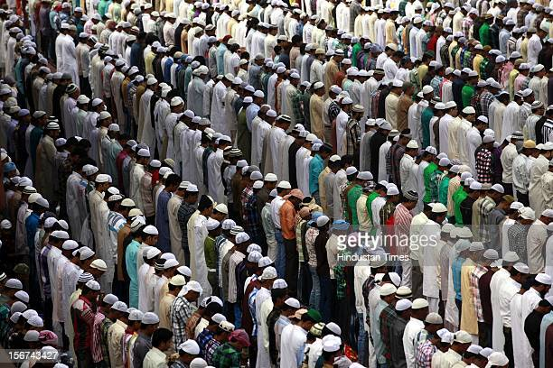 NEW DELHI INDIA AUGUST 20 Muslims take part in Eid alFitr prayers at Jama Masjid on August 20 2012 in New Delhi India Muslims around the world are...