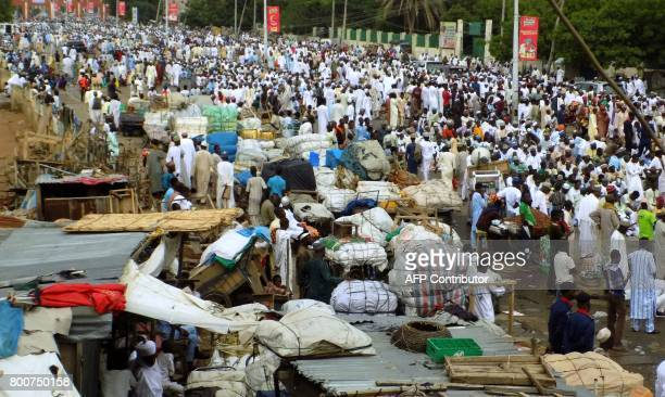 Muslims throng a highway outside the Eid prayer ground in Kano on June 25 as they prepare for prayers to mark the end of the holy month of Ramadan...