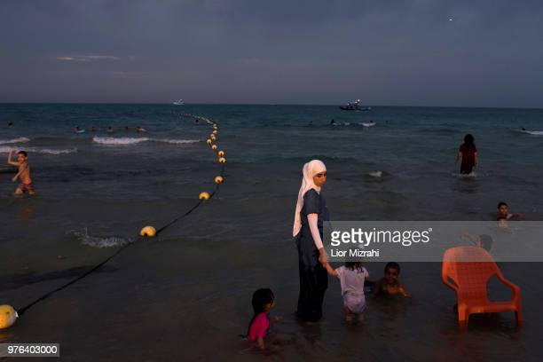 Muslims visit the beach during the Eid alFitr holiday on June 16 2018 in Tel Aviv Israel Muslims around the world are celebrating Eid alFitr the...