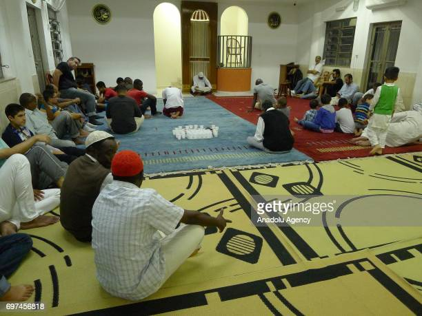 Muslims wait for the prayer after the iftar dinner during the holy month of Ramadan which is the ninth month of the Islamic calendar at a mosque in...