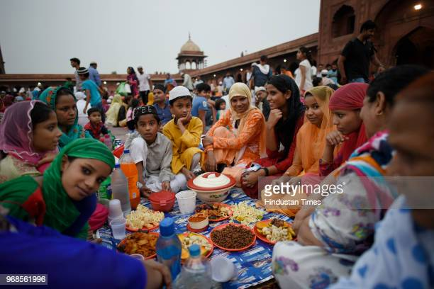 Muslims wait to break their fast on the 21st day of holy fasting month of Ramadan at Jama Masjid on June 6 2018 in New Delhi India Devotees throng...