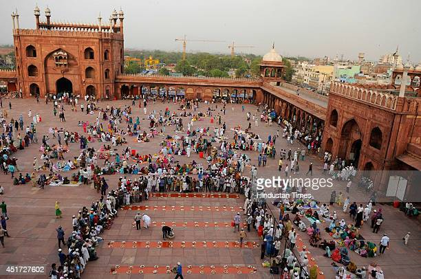 Muslims wait to break their fast on the first friday of holy fasting month of Ramadan at Jama Masjid on July 4 2014 in New Delhi India Muslims...