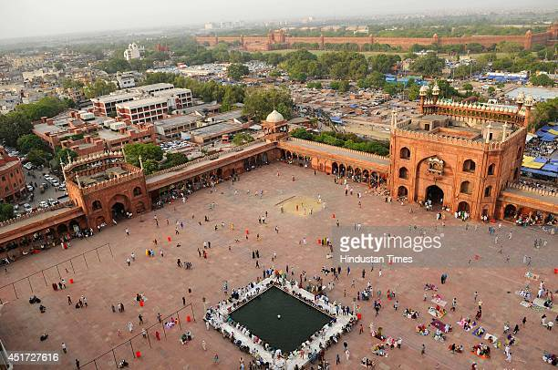 Muslims wait to break their fast on the first friday of holy fasting month of Ramadan, at Jama Masjid, on July 4, 2014 in New Delhi, India. Muslims...