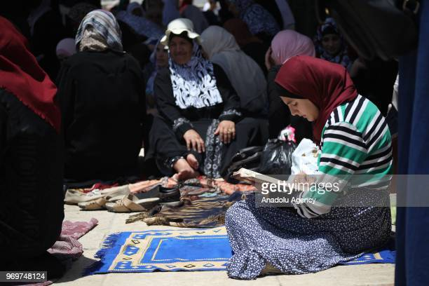 Muslims wait to perform the last Friday Prayer in Muslims' holy fasting month of Ramadan at Al-Aqsa Mosque Compound in Jerusalem on June 08, 2018.