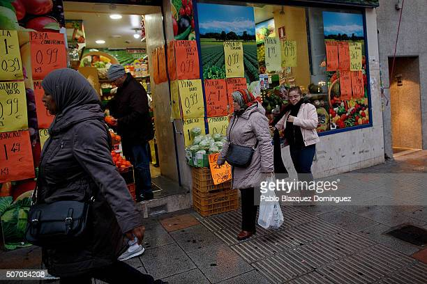 Muslims walk in the street on January 30 2015 in Madrid Spain More than 17 million Muslims live in Spain which is around the 36 percent of the...