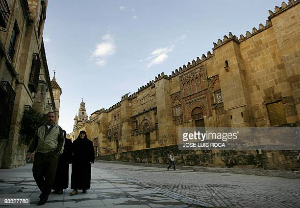 Muslims walk outside the great mosque in Cordoba 01 February 2007 Cordoba residents still often call the building 'mezquita' though it has in fact...