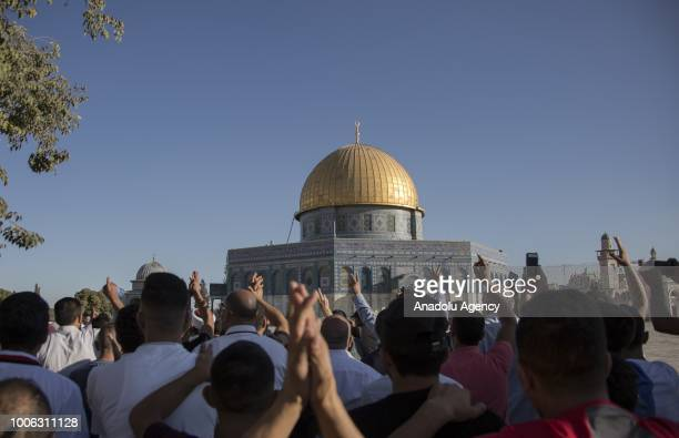 Muslims walk towards the Dome of the Rock as they enter the AlAqsa Mosque as it is reopened after it was closed by Israeli forces following the...