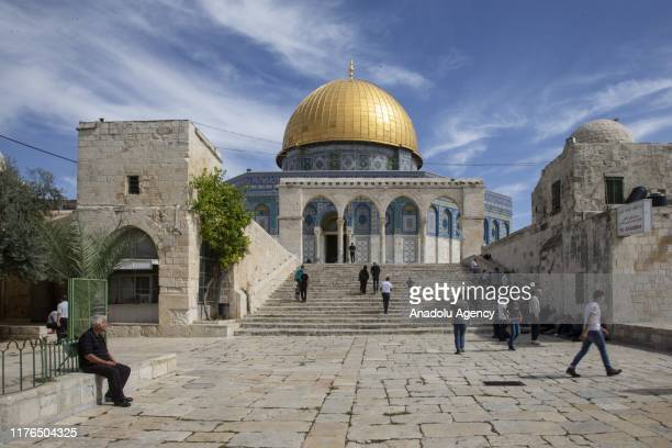 Muslims walk towards the Kubbet'usSahra as they arrive to perform the Friday Prayer at AlAqsa Mosque Compound in Jerusalem on October 18 2019