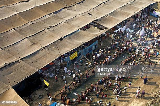 TONGI DHAKA DHAKA BANGLADESH Muslims wash themselves before the Friday prayer in the streets close to the congregation ground during the first day of...