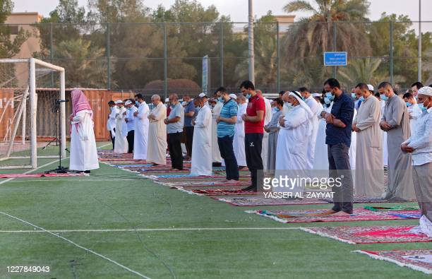 Muslims worshippers perform prayers at a stadium in Bayan district in Kuwait City on July 31 2020 on the first day of Eid alAdha Eid alAdha is...