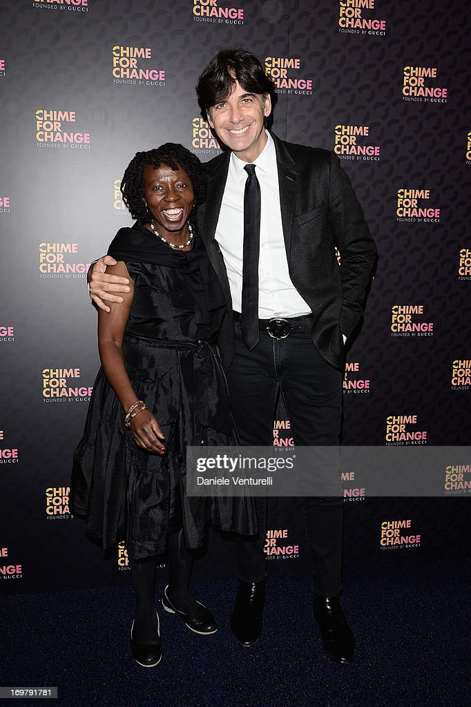 Musmubi Kanyoro and Patrizio di Marco arrive at the Royal Box photo wall ahead of the 'Chime For Change: The Sound Of Change Live' Concert at Twickenham Stadium on June 1, 2013 in London, England. Chime For Change is a global campaign for girls' and women's empowerment founded by Gucci with a founding committee comprised of Gucci Creative Director Frida Giannini, Salma Hayek Pinault and Beyonce Knowles-Carter.
