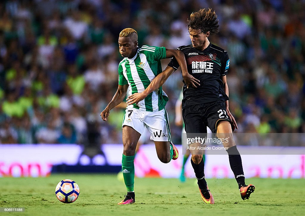 Musonda JR of Real Betis Balompie (L) being followed by Rene Krhin of Granada CF (R) during the match between Real Betis Balompie and Granada CF as part of La Liga at Benito Villamarin stadium on September 16, 2016 in Seville, Spain.