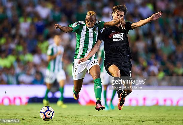 Musonda JR of Real Betis Balompie being followed by Rene Krhin of Granada CF during the match between Real Betis Balompie vs Granada CF as part of La...