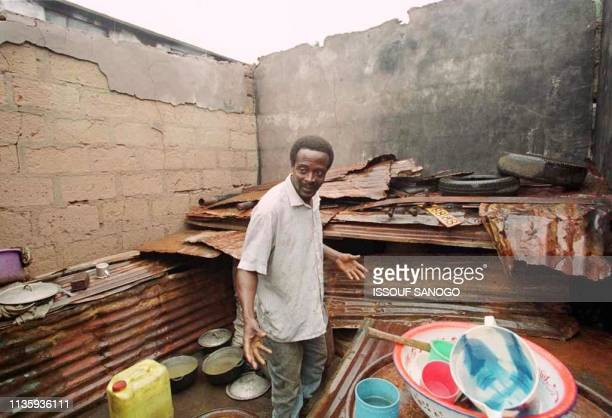 Mussa Sessey shows his family's house 09 July 1999 in Freetown which was reportedly destroyed by RUF rebels A peace deal was reached 07 July 1999 in...