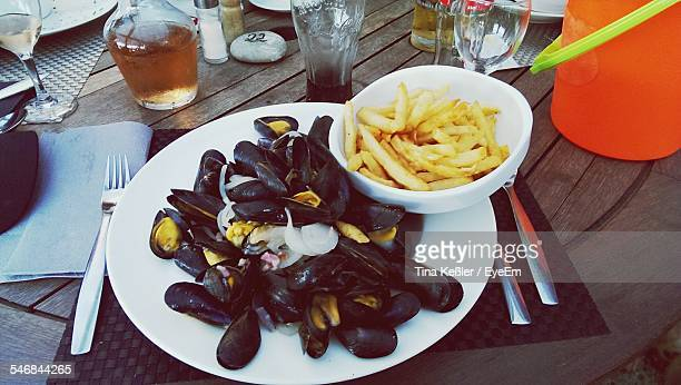 Mussels And French Fries On Table