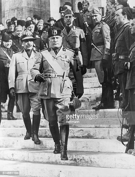 Mussolini in the mid-1930's surrounded by his corps of officers. Photograph.