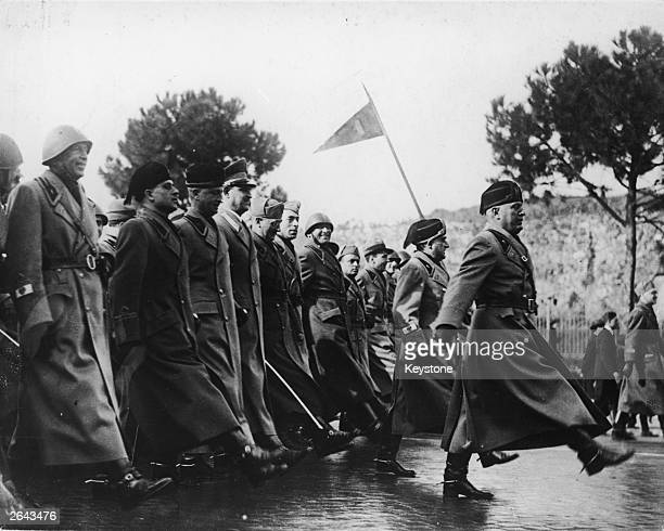 Mussolini leading Fascist officials marching to the 'Goose Step' during a parade of Fascist Militia in Rome