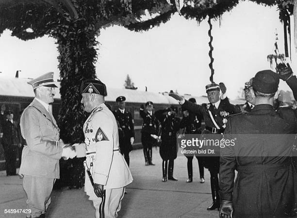 Mussolini on a state visit to Germany Adolf Hitler welcoming Benito Mussolini at the station Heerstrasse in Berlin Photographer PresseIllustrationen...