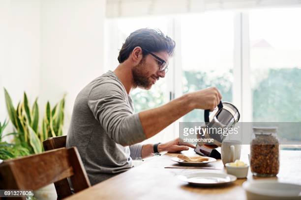 must have coffee for the day ahead - one man only stock pictures, royalty-free photos & images